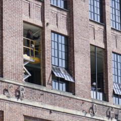 Installing new windows at Hercules Lofts